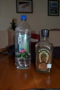 On the right is the tequila bottle Stephanie smuggled out of Jim's Festivus party in her cleavage.