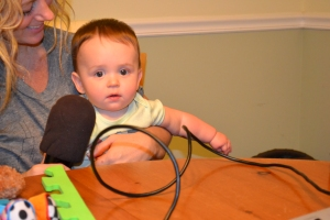 Sam really likes playing with mic cords